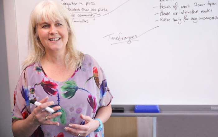 Angela Bensemann at whiteboard